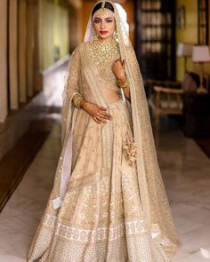 The Most Offbeat & Unique Sabyasachi Lehenga Colours That We Spotted On Real Brides Off Late! Pretty beige-ivory lehenga by Sabyasachi for the wedding day. See more on Golden Bridal Lehenga, Sabyasachi Lehenga Bridal, Indian Lehenga, Pakistani, Summer Wedding Attire, Wedding Dresses For Girls, Simple Lehenga, Bridal Lehenga Collection, Desi Bride
