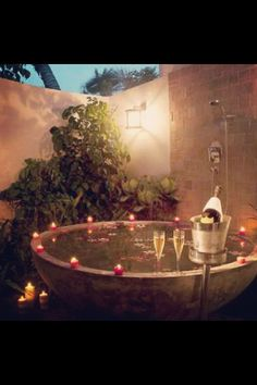 Outdoor bath. , champagne bucket, candles