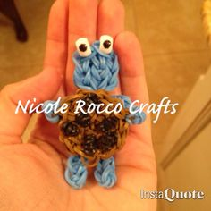 """COOKIE MONSTER and his BIG FAT COOKIE!! Loomed by Nicole Rocco. Find on Rainbow Loom FB page. Nicole said """"Thanks Marlene Barressii Crafts for the Elmo tutorial... I based Cookie Monster [on this] idea..."""""""