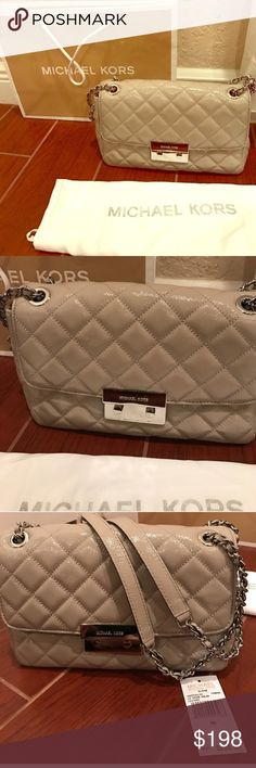 Michael Kors Sloan Purse New with tags, dust bag, and shopping bag. Light gray quilted Sloan. Retired bag! Michael Kors Bags