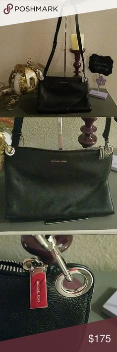 Michael Kors Pebbled Black Leather Cross-body Michael kors Pebbled Black Leather Cross Body Small dent in leather,  Very Clean Make an Offer!! Michael Kors Bags Crossbody Bags