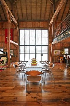 This is what I want, only with a concrete floor, and steel quonset hut structure instead of the hardwood and barnwood. Michigan Barn - contemporary - dining room - chicago - Northworks Architects and Planners
