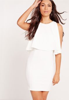 we're lusting over this sizzlin' hot white dress! Featuring frill overlay detailing to the top, super sexy bodycon fit to flaunt your killer bod' and high neck style. all eyes will be on you! team up with barely there heels and matching clu...