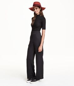 Pants in a woven fabric with wide flared legs, high waist, and concealed side zip.