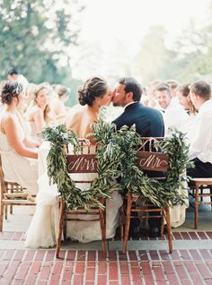 A kiss for the sweethearts: http://www.stylemepretty.com/2016/02/16/english-garden-style-wedding-in-california/ | Photography: Michele Beckwith - http://michelebeckwith.com/