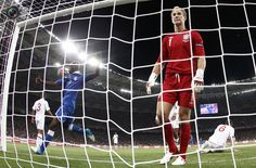 Italy's Balotelli reacts after missing a chance to score next to England's goalkeeper Hart during their Euro 2012 quarter-final soccer match at the Olympic stadium in Kiev. EDDIE KEOGH/REUTERS