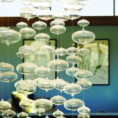 This light fixture reminds me of champagne bubbles.     Eco design goes glam in San Francisco | Floating fixture | Sunset.com