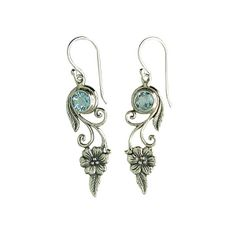 Beautiful drop earring with flower motif, set with blue topaz gems  Silver 925