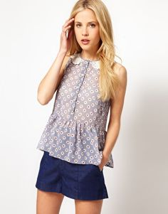 Enlarge ASOS Sleeveless Peplum Blouse With Daisy Print And Crochet Collar--would be so darling with wide leg white linen pants