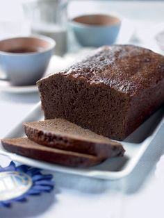 Soft, squidgy and loaded with spice, our ultimate ginger loaf cake recipe makes a tempting teatime treat. If you've never made a ginger cake before. Loaf Recipes, Baking Recipes, Cake Recipes, Ginger Loaf Cake, Gingerbread Cake, Gingerbread Recipes, Thing 1, Strudel, Cake Tins