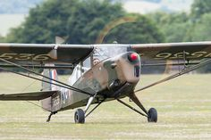 Auster AOP.6 G-BNGE / TW536 taxiing at Middle Wallop airfield.