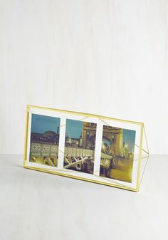 Memorable Dimension Multi-Photo Frame. Like memories in your mind, your treasured photographs appear suspended in time within this prismatic frame. #gold #modcloth