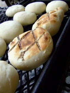 Traditional South African Roosterbrood grilled bread eaten with honey butter sounds yummy!