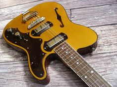 The TimeFlite Archer is a grand tribute to the vintage instruments that powered everything from Chicago blues to the garage band explosion. Music Guitar, Guitar Amp, Playing Guitar, Gold Foil Pickups, Telecaster Thinline, Thing 1, Beautiful Guitars, Bass, Electric Guitars