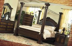 Transform your master bedroom into a luxurious treat from reality with this bedroom collection. The impressive canopy 4-poster bed boasts fluted columns and a tall arched headboard for a regal style. The coordinating bedroom storage pieces feature ornate hardware, burl veneer fronts, and rope edge trim for beautiful style. Finished in a dark cherry, this romantic bedroom collection is the epitome of traditional style.