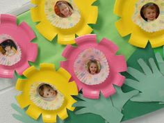 Spring flowers using paper plates, cupcake wrappers, and cut out hand prints
