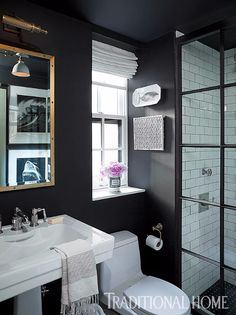 Black paint from Benjamin Moore gives the small bathroom drama and depth. - Photo: Emily Gilbert / Design: Jenny Wolf