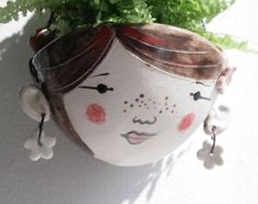 A hand formed stoneware planter with hand painted character. Quirky, rustic and wobbly. Meet Iris. Iris is made to order so please allow 2 weeks for
