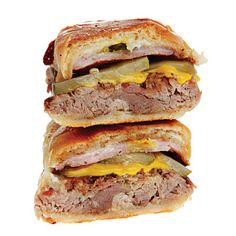 Cubano Sandwich - This sumptuous grilled sandwicha crusty roll filled with roast pork, ham, Swiss cheese, and picklesoriginated in Cuba but has caught on throughout the U.S.