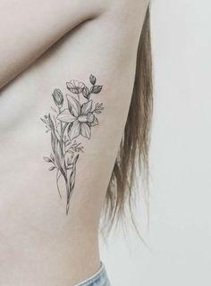 Daffodil for Ashley tattooed by Tritoan Ly , Seventh Day Studio