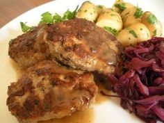 Frikadeller seasoned pork meatballs, roast potatoes and pickled red cabbage. A classic Danish meal.