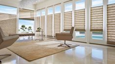 A bright, uncluttered appearance, free from the distraction of exposed rear cords. The whole world looks different with Vignette® Modern Roman Shades. Shift your outlook with Hunter Douglas.