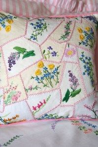 Sewing with old linens. Several embroidered napkins/hankies.