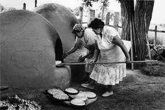 Taos Pueblo, women baking bread for feast day, 1985