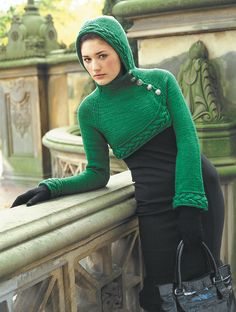 Think I will try to make this a full length sweater, but love the cabled trim and side closure. - Vogue Knitting - Winter 2008/2009 - Ravelry: #09 Green Iiris / Cropped Hoodie pattern by Mari Muinonen / tikru
