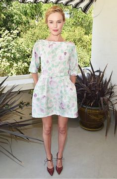 Kate Bosworth looked like perfection in this floral frock, braided crown up-do and mauve lip