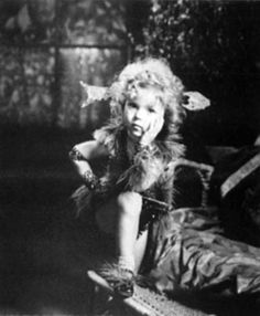 Shirley Temple's - First film and her mother designed her costume. Kid in Hollywood was the name of film, 1933.