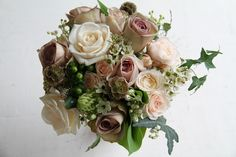 The Flower Magician: A Fabulous Vintage Style Bouquet with quick sand and amnesia roses... wax flower blossom, champagne grass and ivy