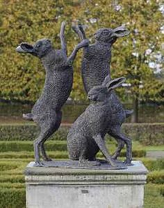 A bronze group of boxing hares -   Wong Lung Hing (b 1921)