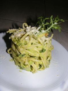"""Avocado """"Alfredo"""" Raw Pasta sauce: Garlic, shallots, salt, parsley, bit of basil and arugula... finely chopped up pine nuts on top... so good... amazing texture. Never making a bechamel sauce again..."""