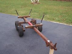 ATV Firewood Trailer by tapper2 -- Homemade firewood trailer for an ATV, constructed from square tubing, wheels, hubs, and pipe. http://www.homemadetools.net/homemade-atv-firewood-trailer