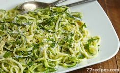 Ingredients: 28 oz. (about 4 medium) zucchini 4 cups roughly chopped cauliflower 1/4 cup plus 1 tbsp. grated Parmesan cheese 2 tsp. chopped garlic 1/4 tsp. each salt and black pepper 1/2 cup fat-free milk Optional topping: chopped fresh basil Directions:  Using a spiral vegetable slicer, cut zucchini into spaghetti-like noodles. (If you don't have a spiral veggie slicer, peel zucchini intothin strips, rotating the zucchini after each strip.) Roughly chop for shorter noodles. Place…