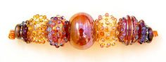 Beautiful colors.... glass blown mini hollow 5 beads strand of by jarisheese...