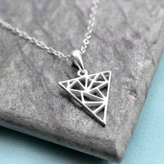 Sterling Silver Geometric Triangle Pendant Necklace by Martha Jackson Triangle Necklace, Geometric Necklace, Geometric Jewelry, Jackson, Silver Necklaces, Silver Jewelry, Silver Rings, Argent Sterling, Sterling Silver