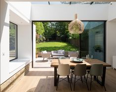 Open Plan Extension- Campbell Cadey - Woodlane Pavilion Clean lines work wonders on this rear brick extension to a London family home, with sliding glass doors and a window seat. Small Cottage Kitchen, Open Plan Kitchen Living Room, Farmhouse Style Kitchen, Modern Farmhouse Kitchens, Brick Extension, House Extension Design, Glass Extension, House Design, Extension Ideas