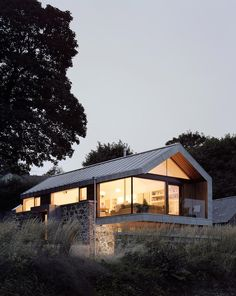 | Loughloughan Barn | A small home built around an existing stone barn structure in Broughshane, Northern Ireland, UK. Designed by McGarry-Moon Architects. Photos courtesy of McGarry-Moon Architects. ~ click on photo for more ~