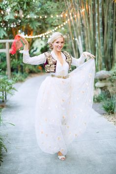 For the reception, Lauren wore a 100-year old Albanian gown that has survived several wars, and has been passed throughout the women of the family. Everyone participated in a traditional circle dance too.