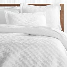 Stitched and quilted by hand, Celeste textures pure white cotton with a classic pick stitch, a hallmark of handcrafted textiles. Edged with light and airy flanges, the duvet cover layers the bed with subtle patterning, mixing well with prints and solid colors. Constructed like a quilt, this duvet cover can be used with an insert for cooler temperatures, or without during the warmer months.. Duvet inserts also available.