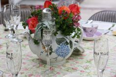 Centerpiece plus old insulator on top of candlestick.  Adds a vintage charm to table.