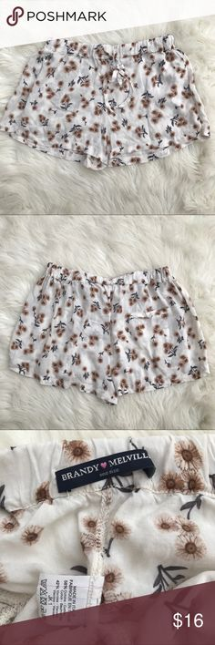 """Brandy Melville Floral Summer Shorts Excellent condition Brandy Melville Shorts  Cream with brown floral designs Drawstring   One size 1.5"""" inseam 11"""" rise 12"""" waist 10.5"""" inseam   These are SO cute and SO comfortable.  Pair these with a crop top, t-shirt, or a Bodysuit for a fun summer look! Brandy Melville Shorts"""