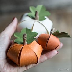 Make your own cute paper pumpkins for Halloween - suitable for children. Design and pattern by handcrafted lifestyle expert Lia Griffith.