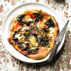 Best Vegetarian Pizza Recipes: Broccoli, olive & smoked mozzarella (baked) recipe, from 'Franco Manca Artisan Pizza to Make Perfectly at Home'. Click the image to find the full recipe at redonline.co.uk