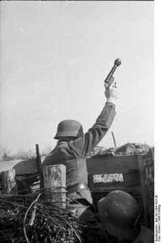 German soldier in position with a Kampfpistole ( grenade laucher pistol).France  21 March 1944