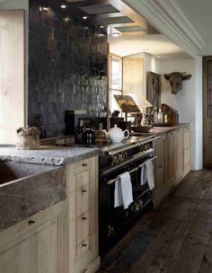 Kitchen with black zelliges, oak wood cabinets Rouge Belge Belgium marmer stone work tablet
