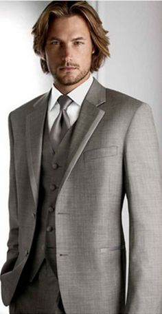 Mr. Dreamy here! Love this grey/ silver color tux. It's called Grey Legend Tuxedo from Calvin Klein. combines classic tradition with current fashion for a look that is, well, legendary. Would like men to wear a Grey Legend tuxedo like this guy is wearing (No lighter than this one) with grey vest, grey tie, white shirt. black shoes and black belt. Don't need handkerchief but if want one, then go with the grey that goes with suit.