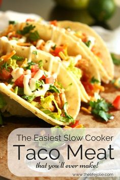This is seriously the Easiest Slow Cooker Taco Meat Ever! It's 4 simple ingredients that you just throw into a bowl and the slow cooker does the rest. It's delicious with chicken, beef or pork! Click on the photo to get the recipe!